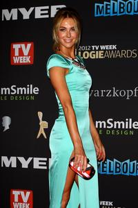 http://img46.imagevenue.com/loc373/th_486363553_Hottest_Miss_Universe_Ever_Logie_02_122_373lo.jpg